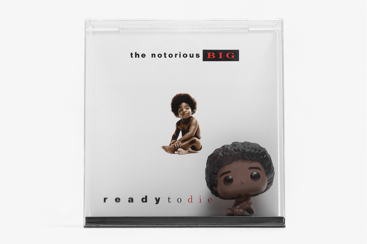 The Pop Vinyl Albums set features the typical Funko POP! vinyl figure as well as the album cover artwork in a plexiglass case.